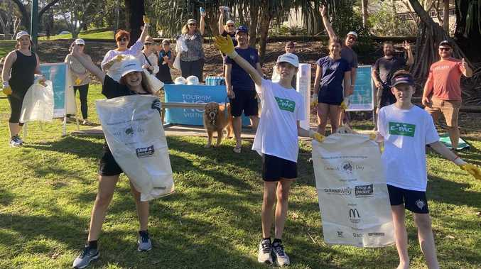 Kids pick up pieces of beach plastic scourge
