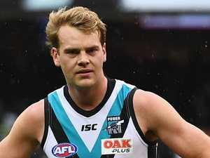 Ex-AFL star 'charged' over fender bender