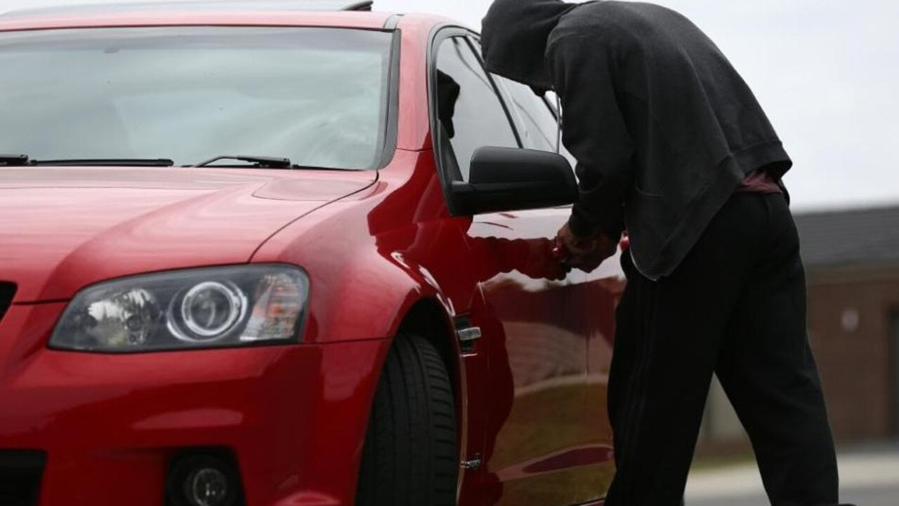 generic photo of a person stealing a car