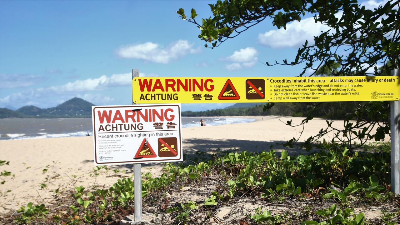 A sign at the southern end of Palm Cove beach alerts visitors to a recent croc sighting in the area. PICTURE: PETER CARRUTHERS
