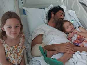 Dad fights brain bleed as $100k raised
