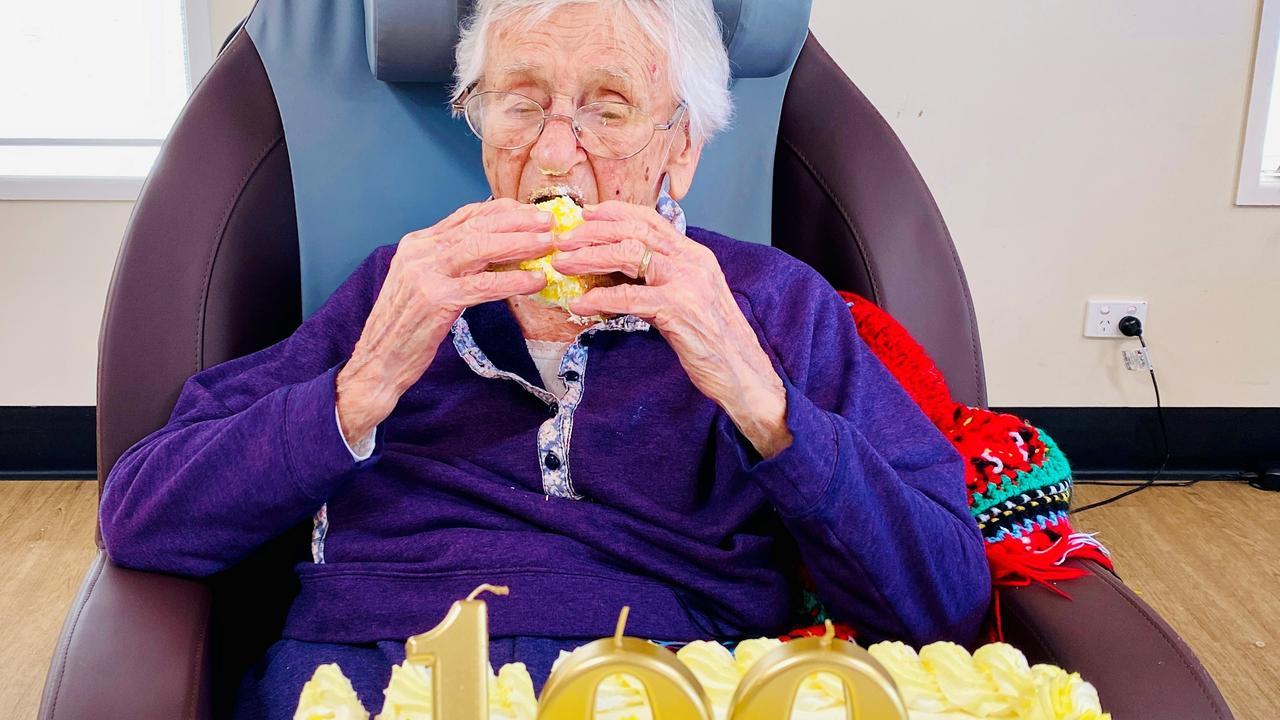 Karinity Carinya aged care resident Mavis Cumner enjoys some cake as part of her 100th birthday celebration. (Photo: Supplied)