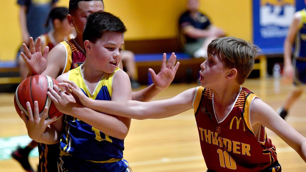 Queensland junior basketball championships at Townsville Basketball Stadium. Townsville Heat u12 boys against Logan. Heat's Jaxon Hartwell and Logan's Matthew McGrath. Picture: Evan Morgan