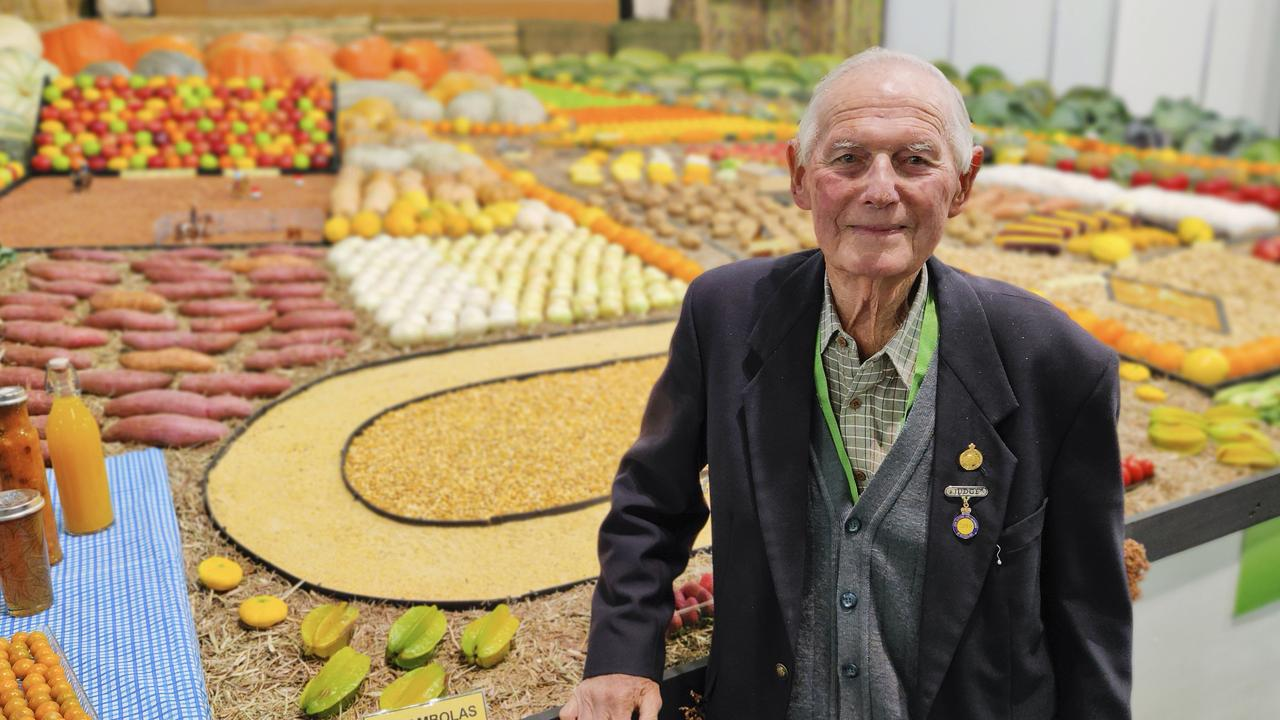 Syd Haag at the Ekka in 2019 with a display of vegetables that he helped create. It was his 71st and last Ekka.