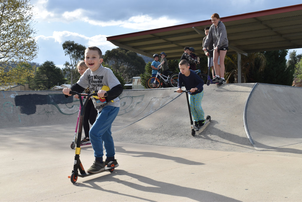 Image for sale: SKATE ON: Cooper Robertson is all smiles as he skates down the skatebowl.
