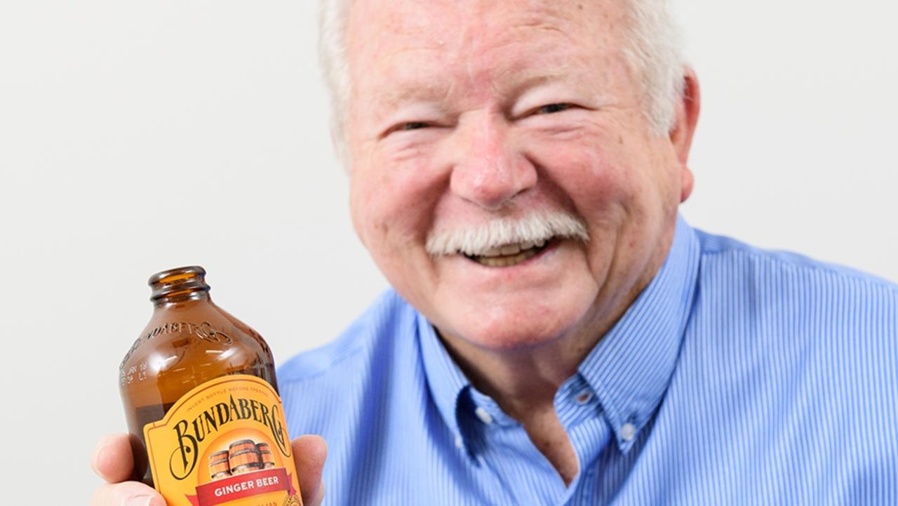 Bundaberg Brewed Drinks founder Cliff Fleming with bottle of the iconic brand's ginger beer.