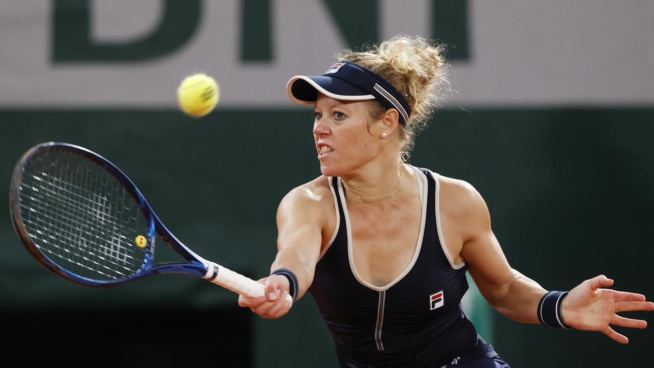 Laura Siegemund of Germany plays a forehand during her Women's Singles first round match against Kristina Mladenovic of France. Picture: Getty Images