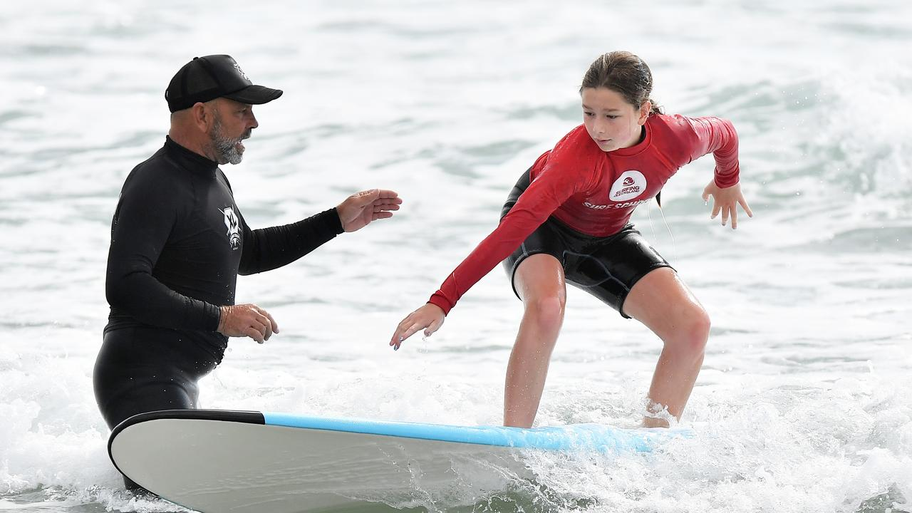 A junior surfer takes a few tips during a Robbie Sherwell's XL Surfing Academy lesson at Alexandra Headland. Picture: Patrick Woods / Sunshine Coast Daily.