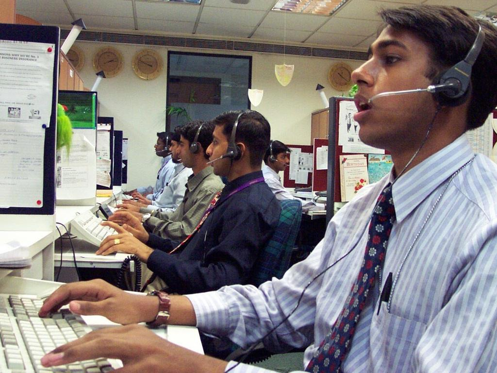 Workers at a call centre in Delhi. Picture: Greg Stitt