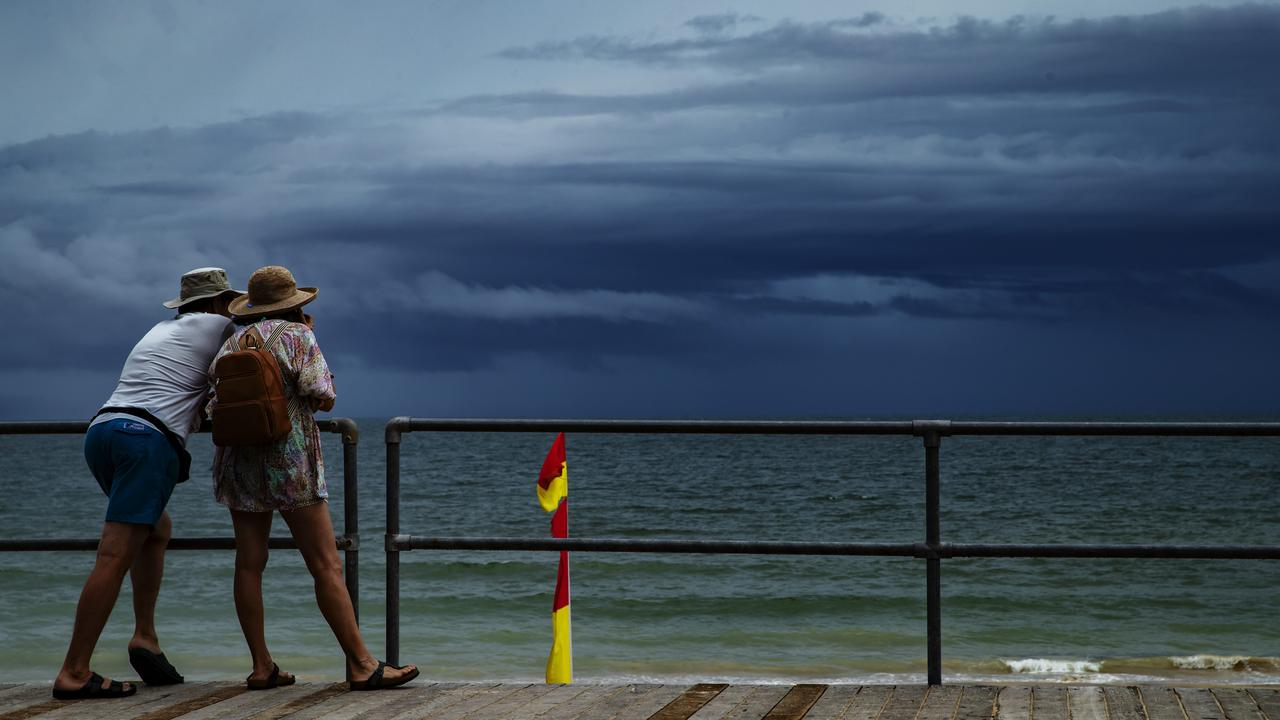 Tourists watch a storm approach at Noosa Main Beach earlier in the year. Photo: Lachie Millard
