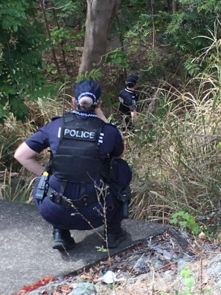 Police scour the riverbank near Victor St after a woman was attacked on Wednesday morning.