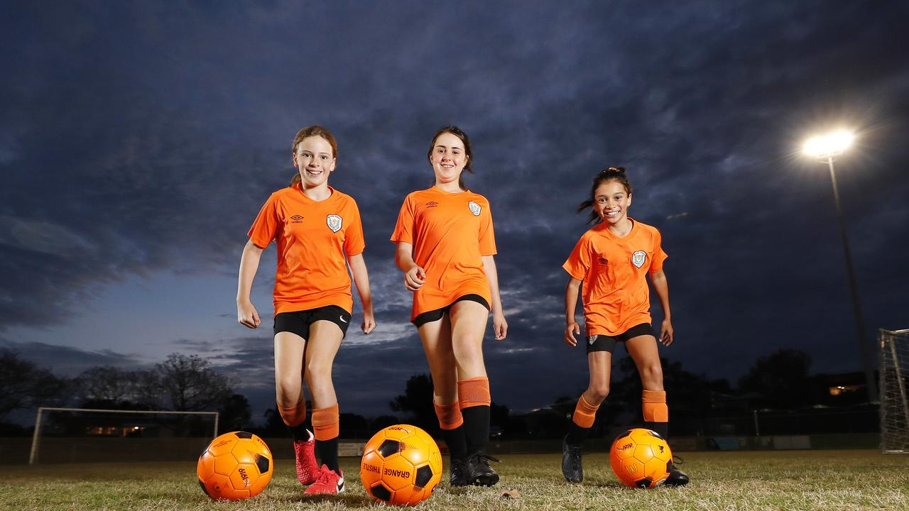 Lauren Vickers, 10, Asher Osborne-Millard, 10, and Kaia Taniora, 10, from Grange Thistle Football Club. Picture: Josh Woning