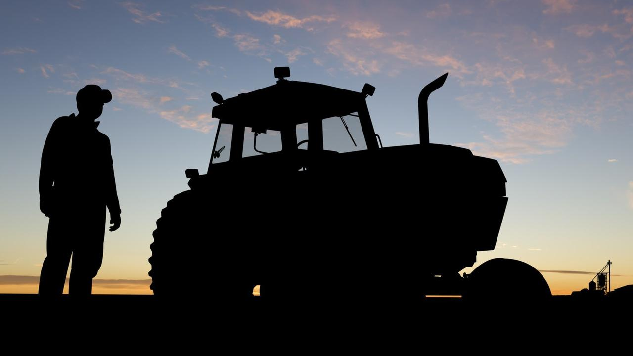 There is nothing quite like standing silhouetted next to your tractor after a hard day behind the wheel.