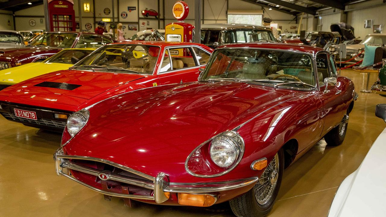 Gold Coast brothers Carl and Grant Amor will soon open the Gold Coast Motor Museum at Upper Coomera. Ferrari Mondial and 1969 Jaguar E-Type. Picture: Jerad Williams