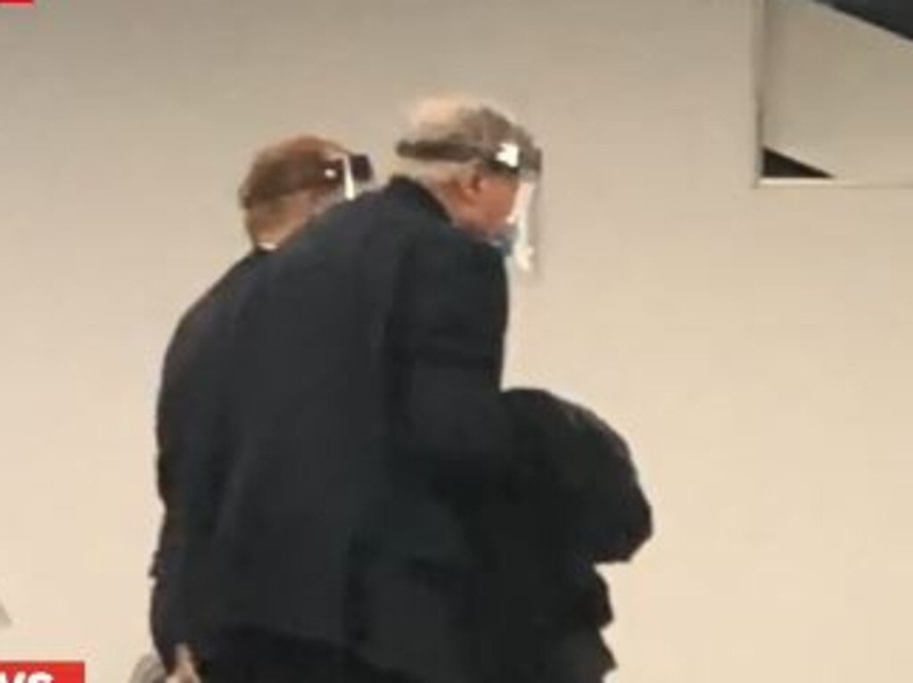 Pell was spotted boarding a Qatar flight according to Nine News. Picture: Nine.