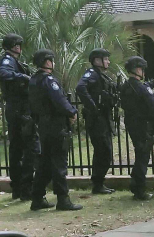 Heavily armed police at Bribie Island. Photo: Rohmana Thompson