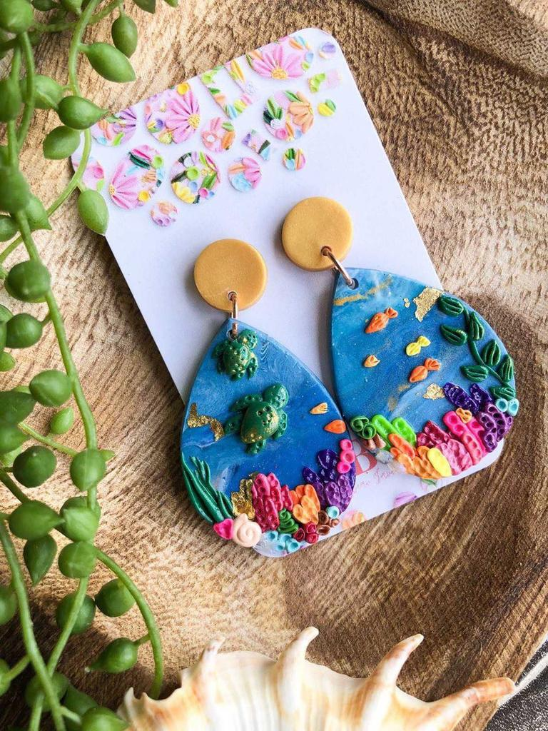 TOURISM PARTNERSHIP: Maddison Devine from Jellybean Jane has released a stunning collection inspired by the Great Barrier Reef and the earrings are available exclusively at the Bundaberg Tourism Information Centres.