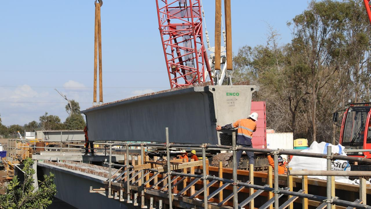 The concrete beam being lowered.