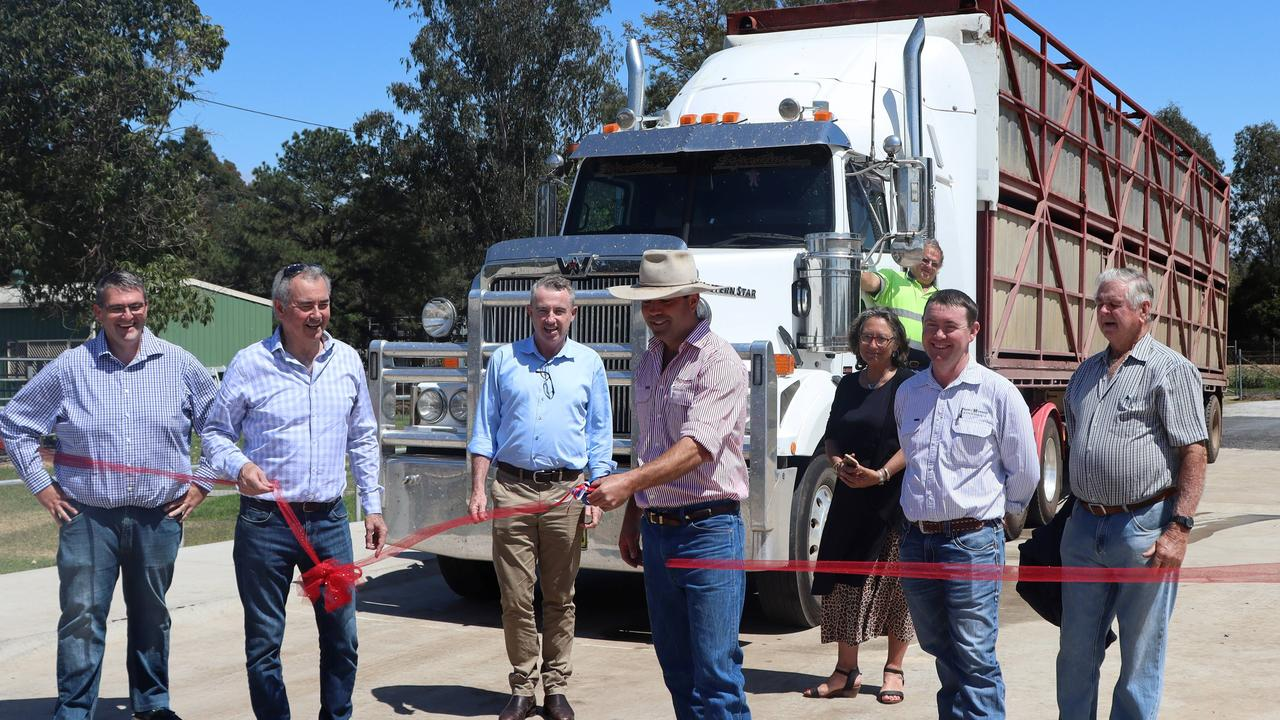 Local MP's Kevin Hogan and Chris Gulaptis, Council reps Crs Richie Williamson and Debrah Novak, Stock & Station Agent Ben Clarke, Vendor Bruce Finlay and truck driver Barry McKey look on as local Stock & Station Agent, Mitch Donovan does the honours and declares the new truck wash at the Grafton Saleyards open.