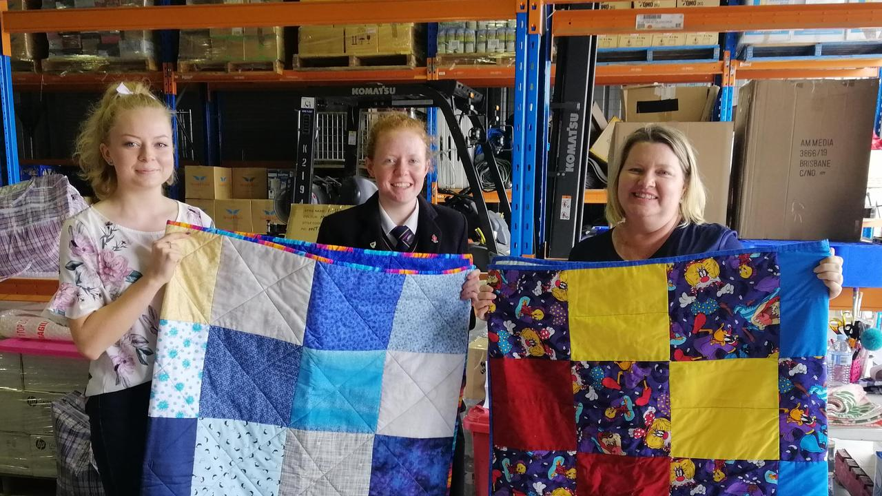 DONATION: Naomi Ryan (past Glennie student), Lauren Ryan (Glennie student) and Natasha Johnston (Drought Angels Co-founder and former Glennie student) view donations that bring joy to those in need. Pic: Supplied