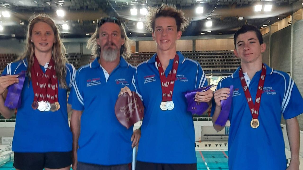 Cannonvale Cannons Mikhaila Flint, coach Mark Erickson, Jy Parkinson and Jacob Bell won a swag of medals at the Queensland Short Course Championships. Photo: Contributed