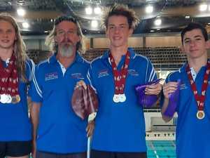 Top of podium: Swimmers win gold medals at state champs