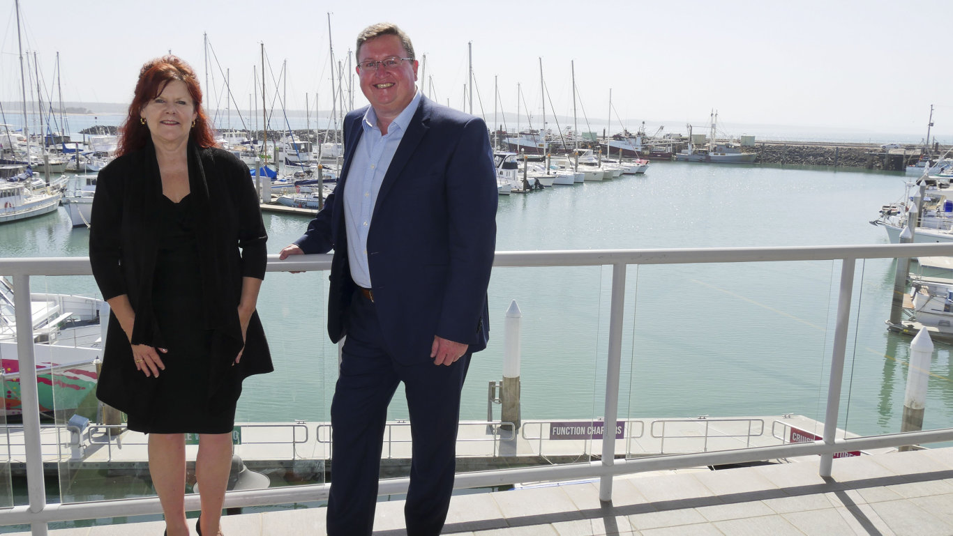Hervey Bay Chamber of Commerce president Sandra Holebrook with director of regional development for the Wide Bay Burnett Scott Rowe at the Boat Club in Hervey Bay overlooking the Urangan Marina which in the future the community hopes to see redeveloped.