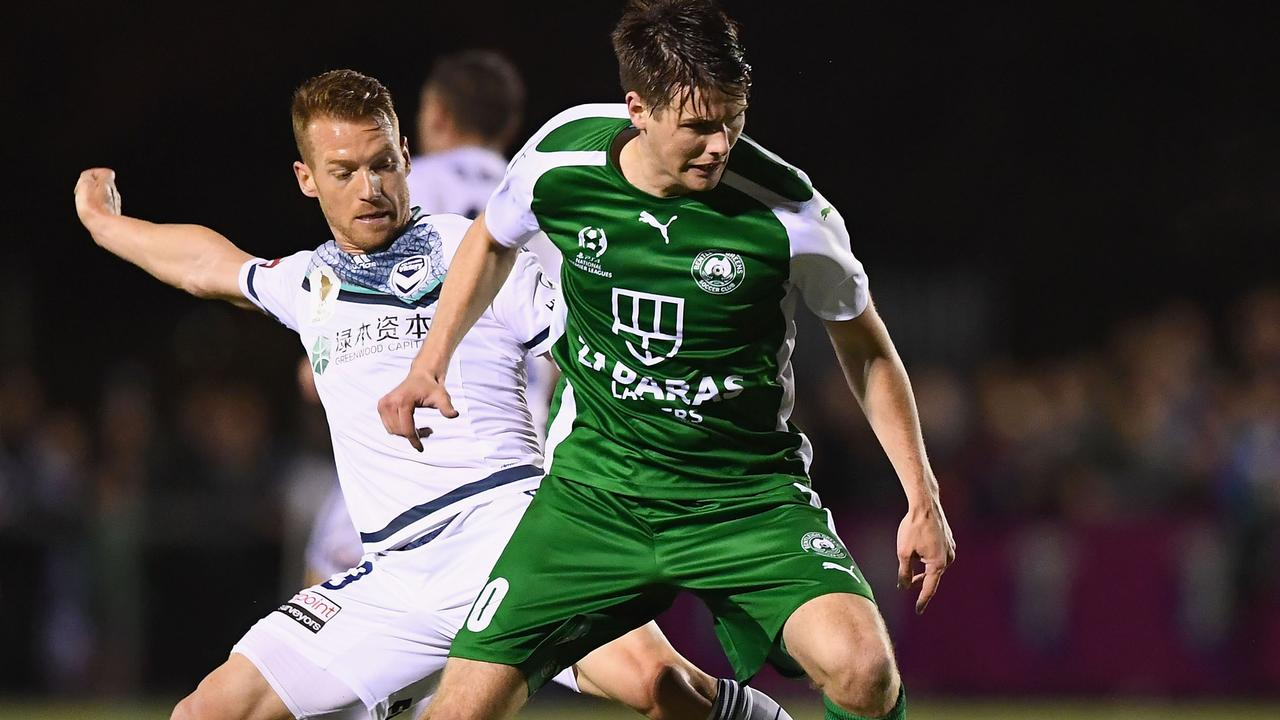 Oliver Bozanic of the Victory and Tyson Holmes of the Greens compete for the ball during the FFA Cup match in 2017. (Photo by Quinn Rooney/Getty Images)