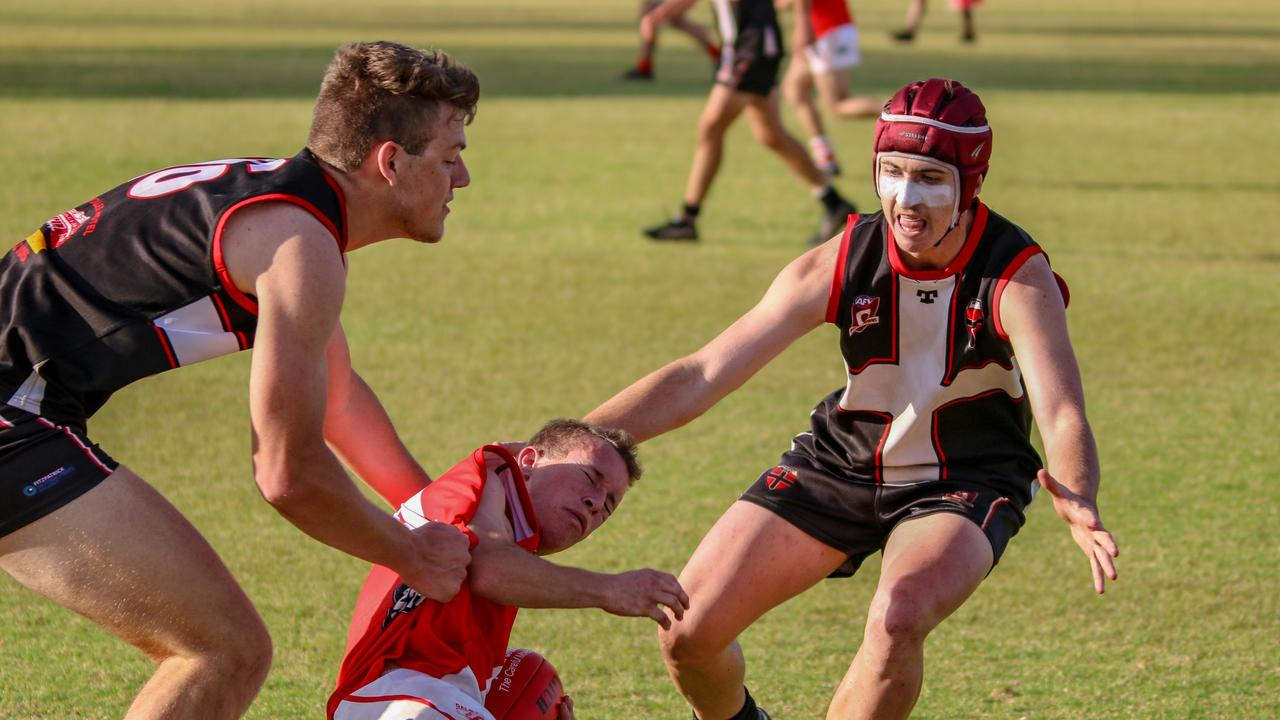 Shaun Pukkalus and James Packer making a tackle against the Dalby Swans. (Picture: Dominic Elsome)