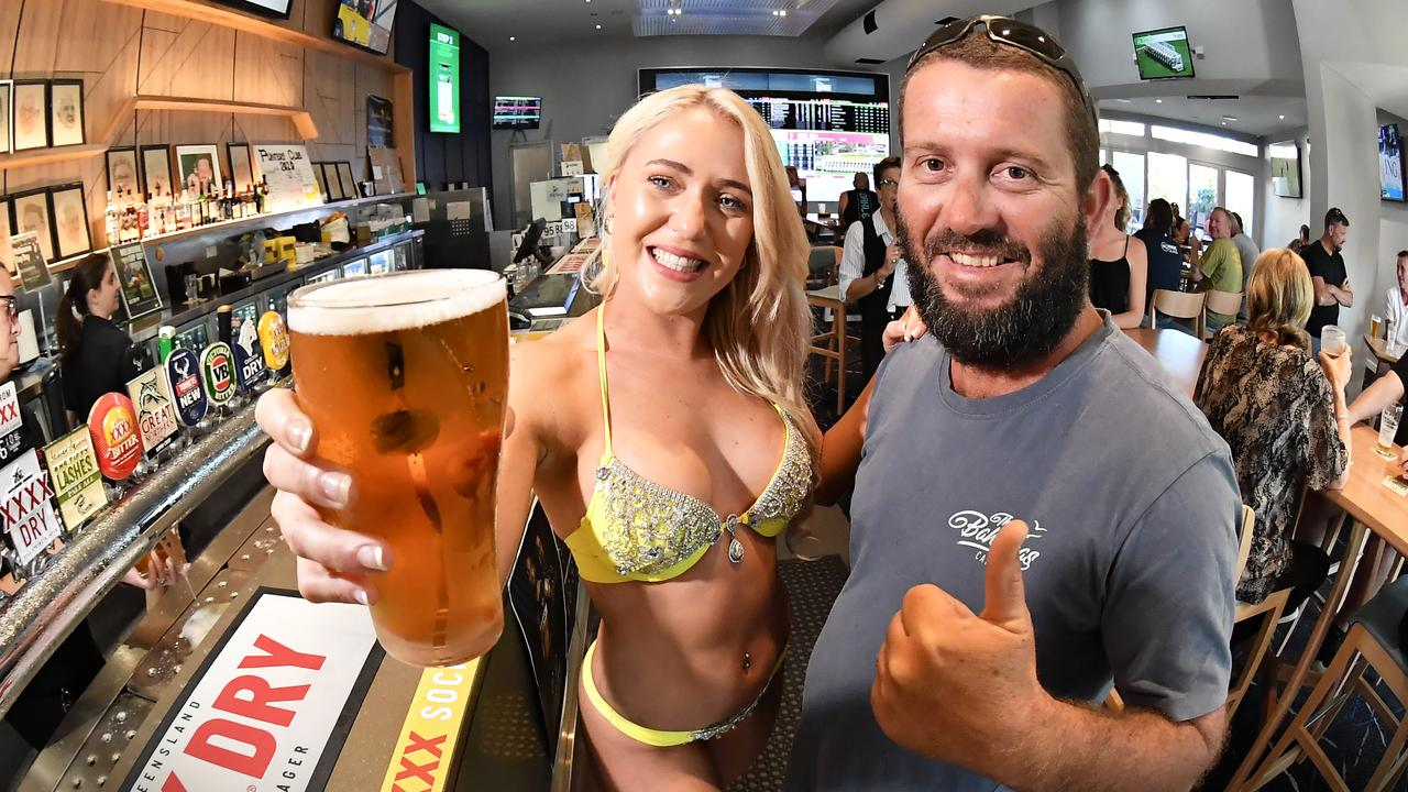 HAPPY DAYS: Layla Innes from Sunshines Finest Models and Damien Hazel at North Shore Tavern enjoy the new virus restrictions. Photo: Patrick Woods