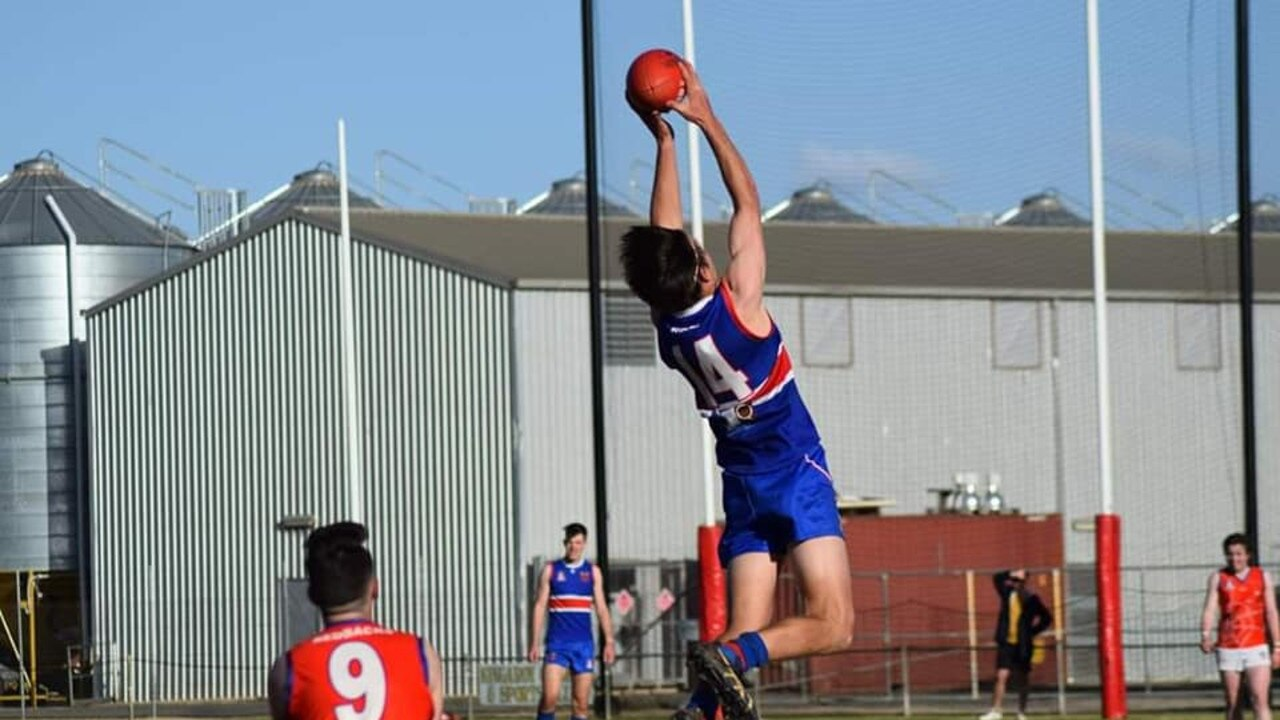 Nathan Trace fully stretched taking a mark against the Warwick Redbacks. (Picture: Social Media)