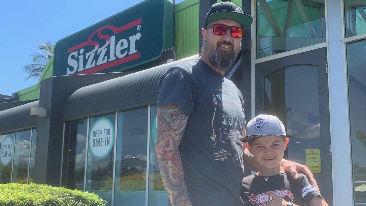 Jai Knarston with dad Matt excited to celebrate his seventh birthday at Sizzler Maroochydore.