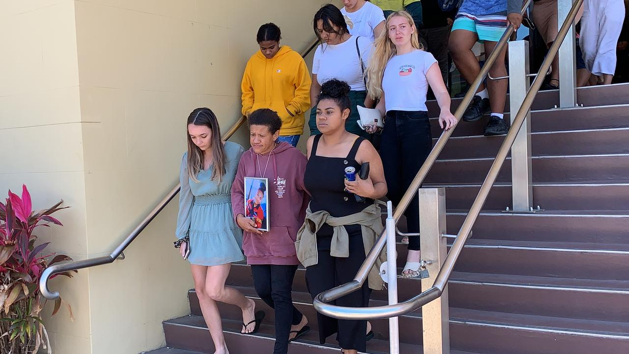 Nilly's mother Tania Rudall holds a photo of her 15 year old daughter as she leaves Mackay courthouse surround by loved ones who came to watch the court case for the driver linked to the schoolgirl's death.