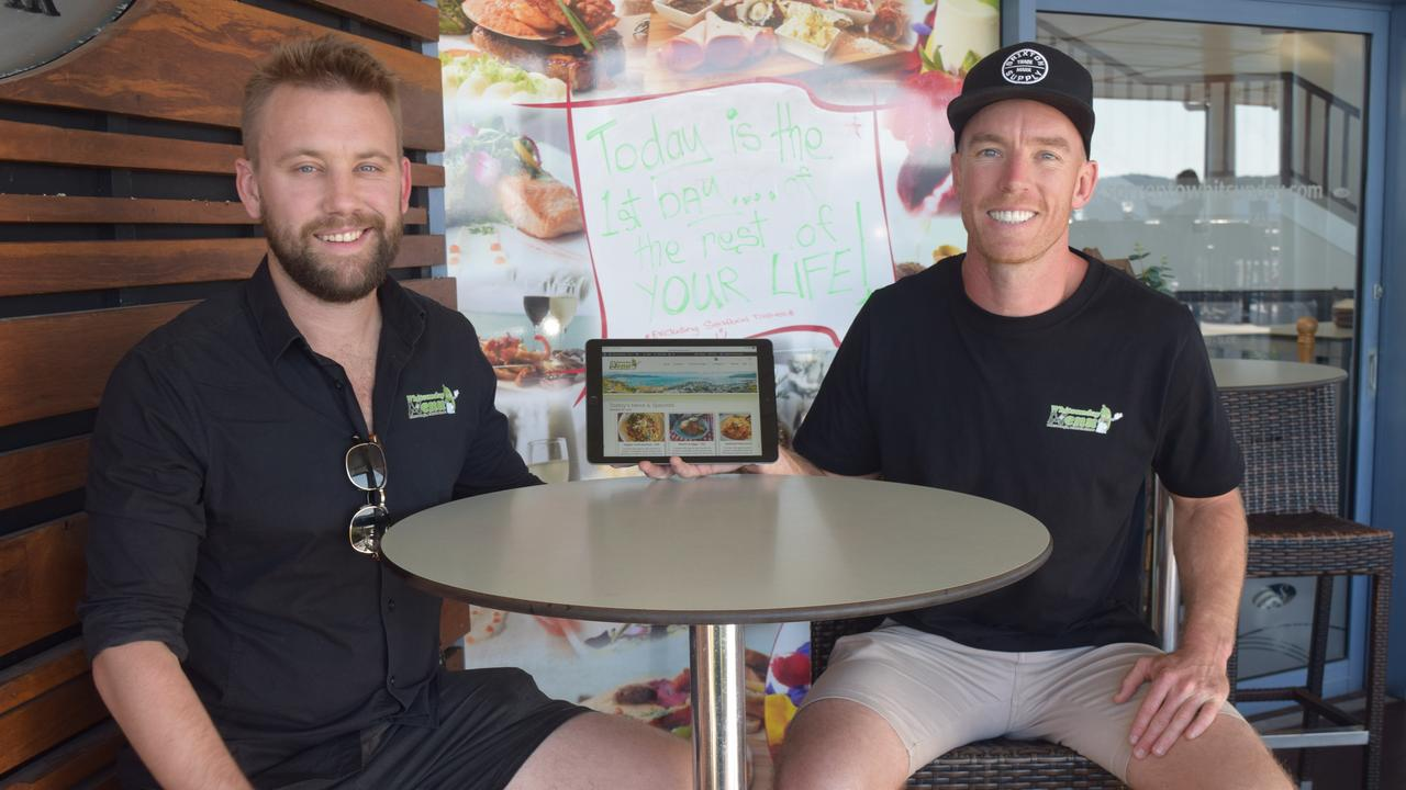 Co-founders of Whitsunday Menu Jono Press and Alex Dakin will bring the menus, specials and deals from Airlie Beach restaurants to your fingertips. Picture: Laura Thomas