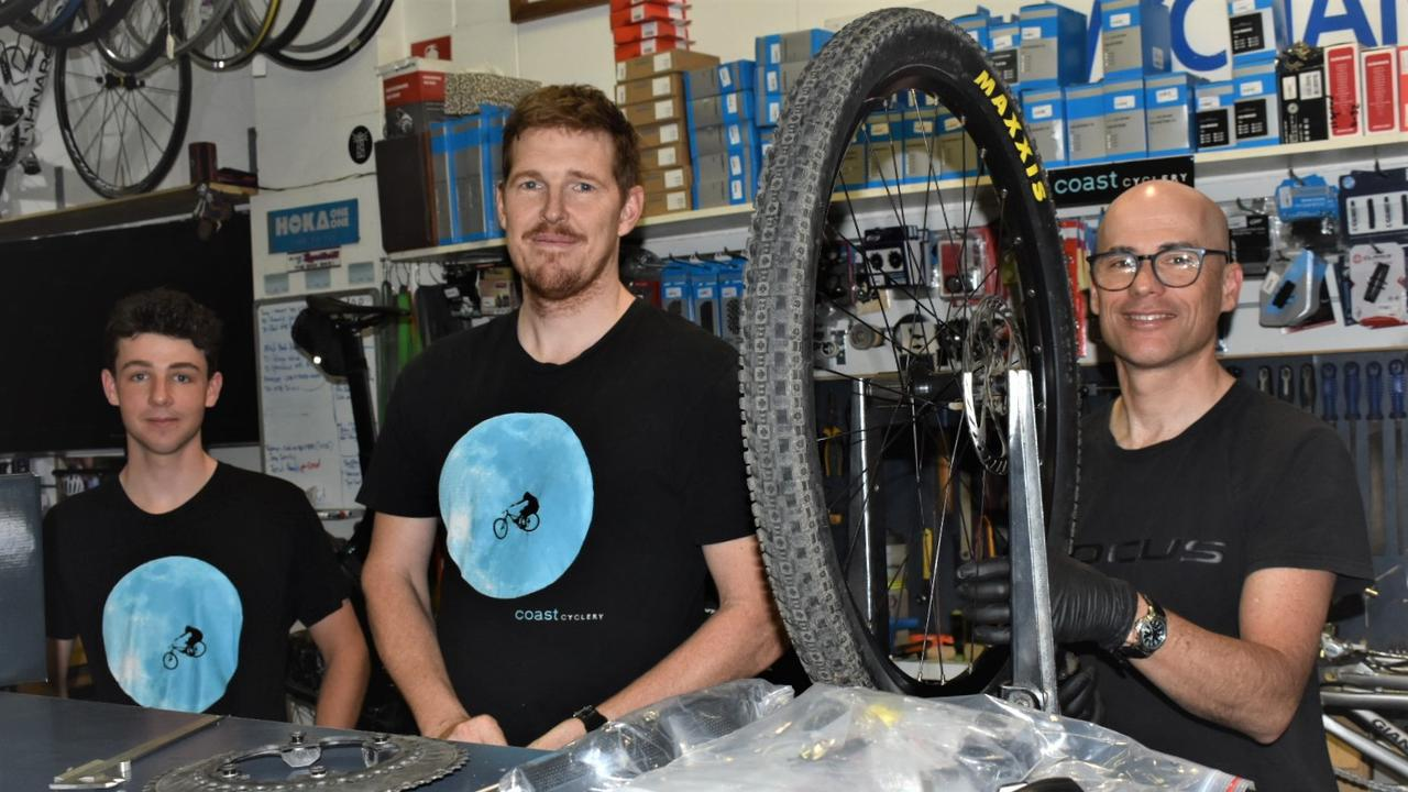 Wharf St shop Coast Cyclery staff Darcy Harris, owner Brendan Brooks and Paul Woodger have noticed more families partaking in cycling during COVID. Photo: Jessica Lamb