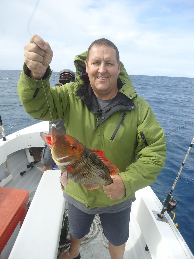 Kim Larcombe with a fine local red throat emperor.