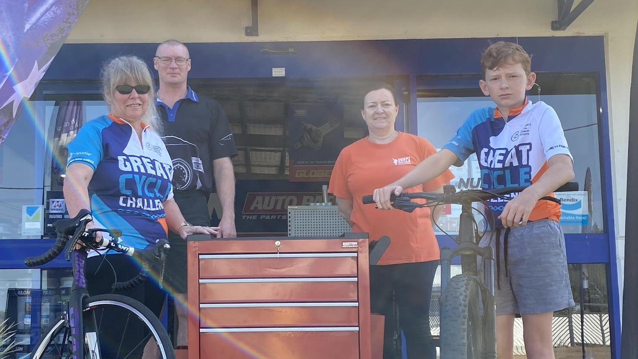 Dianne and Mackenzie Hughes (end, left and right) with the major raffle prize donated by Bursons ahead of their participation in this year's Great Cycle Challenge.