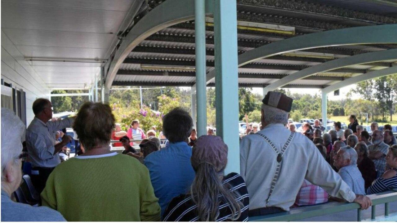 Gympie MP Tony Perrett addresses a packed meeting at Glenwood Community Hall last June.