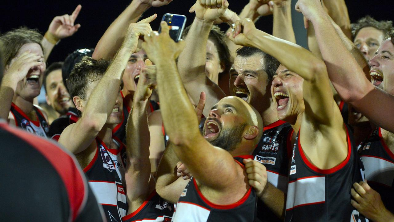 Retiring Saints James Gallagher takes a selfie with his teammates after winning the AFL Mackay Allied Pickfords Cup A-Grade grand final on Saturday night. Photo: Callum Dick