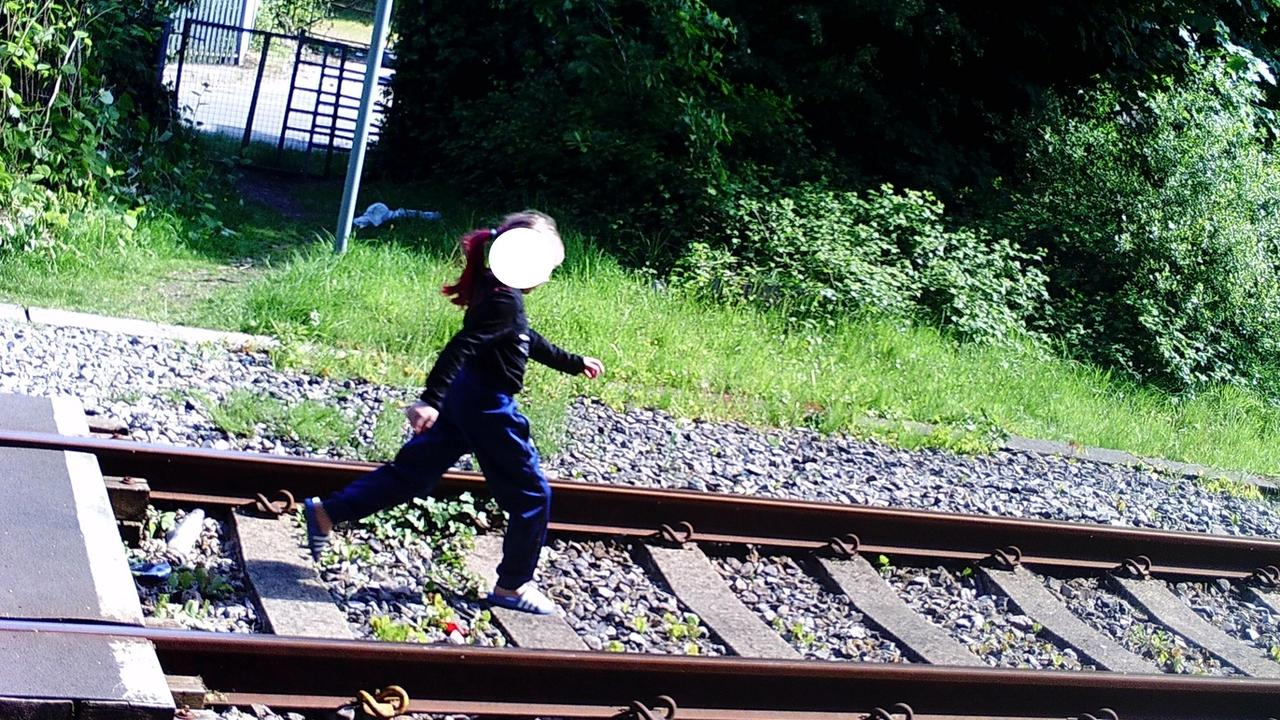 Another image shows a woman strutting down the train line. Picture: Twitter/NetworkRail