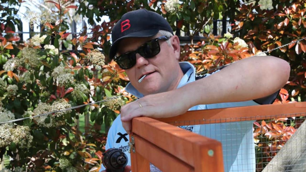 PM Scott Morrison building his back yard chicken coop, which some Facebook and Twitter users say makes him look like Block host Scott Cam. Picture: Facebook.