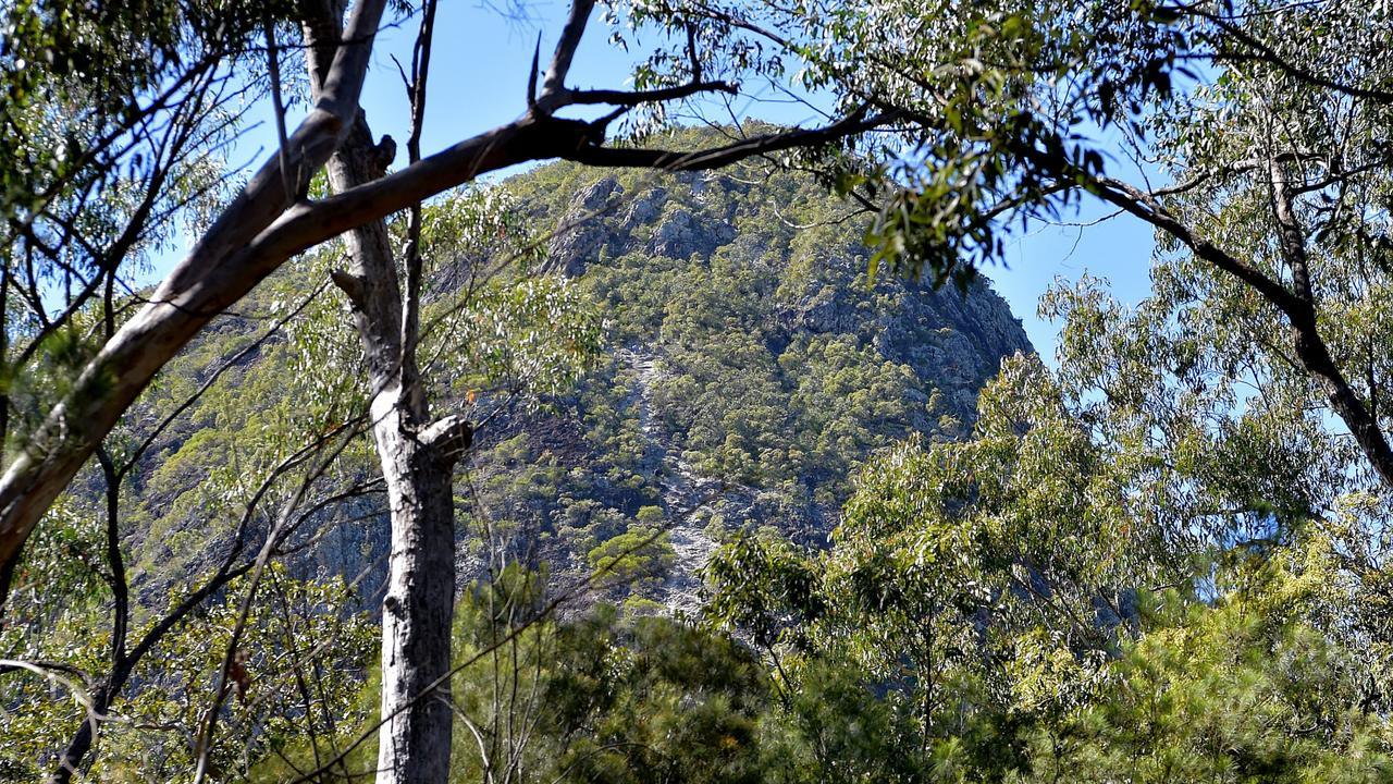 Emergency services are working to retrieve a man who has slid and hurt his leg at Mount Tibrogargan.
