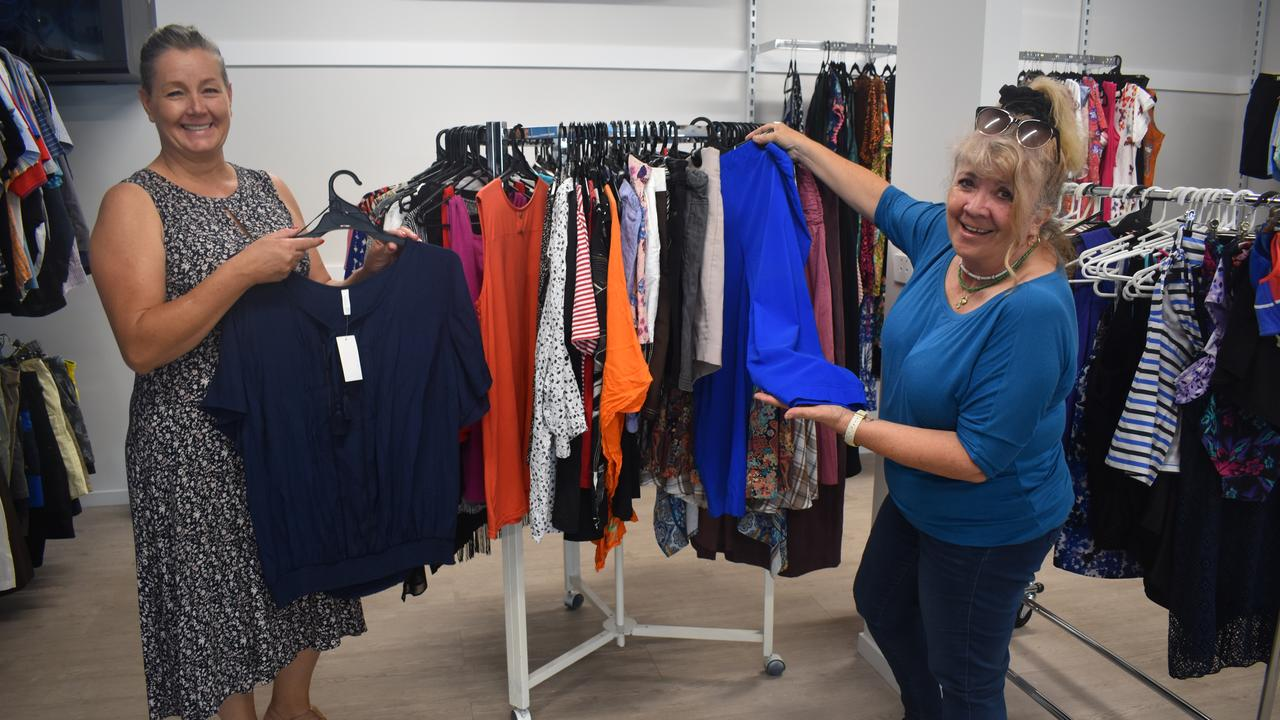 BAYSIDE TRANSFORMATION: (L) Op shop manager Elaine Chander and CEO Tina Davie display clothes for sale at Bayside Transformation's new op shop. Photo: Stuart Fast
