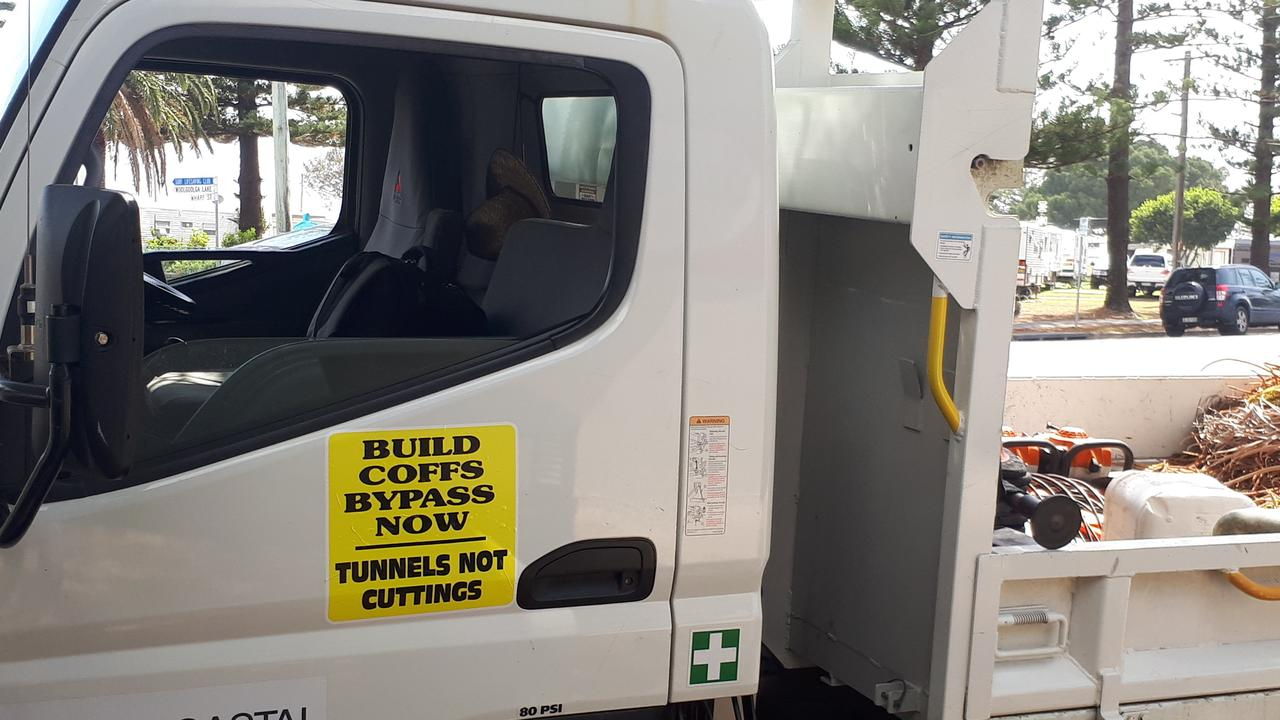 Coffs Harbour City Council's vehicle fleet was fitted with stickers calling for tunnels on the Coffs bypass and not cuttings and landbridges.