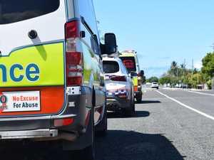 Paramedics treat elderly man after vehicle rollover