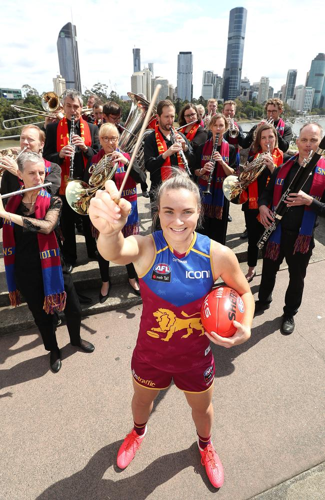 Brisbane Lions AFLW Best and Fairest player Emily Bates with the Queensland Symphony Orchestra. Picture: Peter Wallis