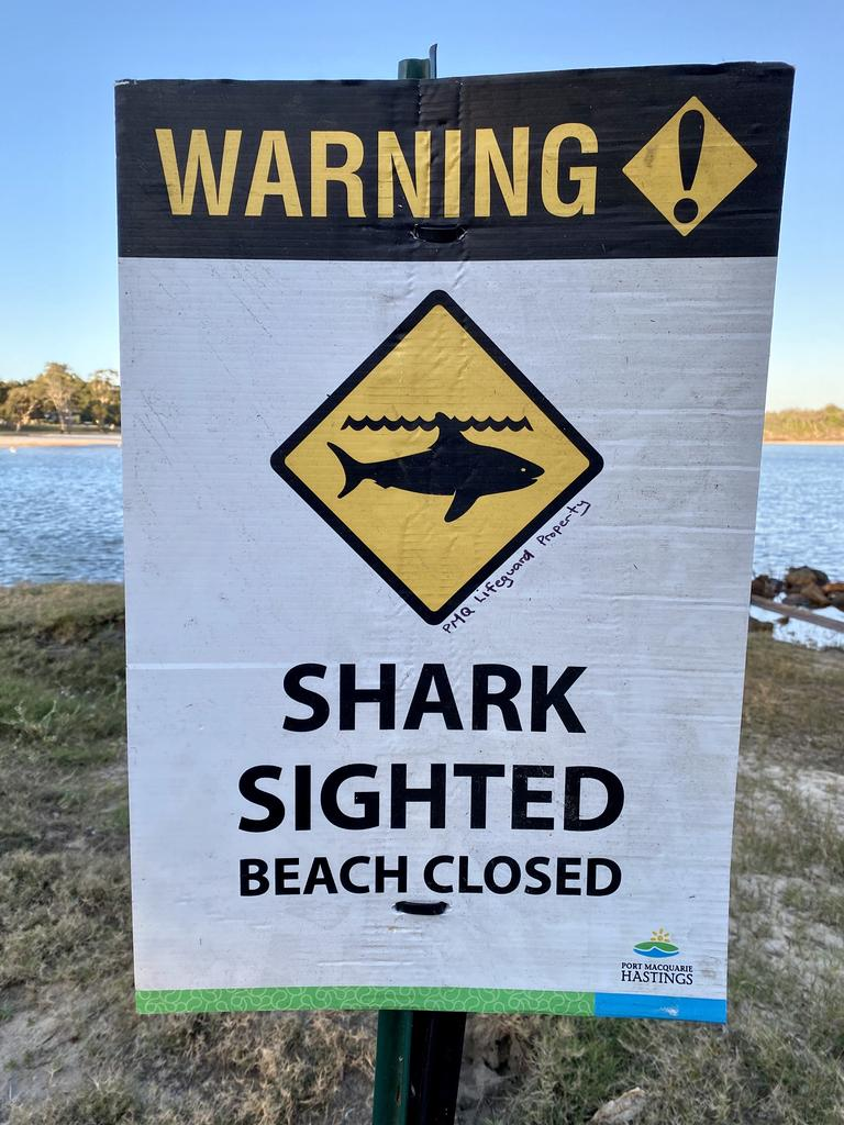 Warning signs posted after a shark sighting in Lake Cathie south of Port Macquarie. Picture: Nathan Edwards