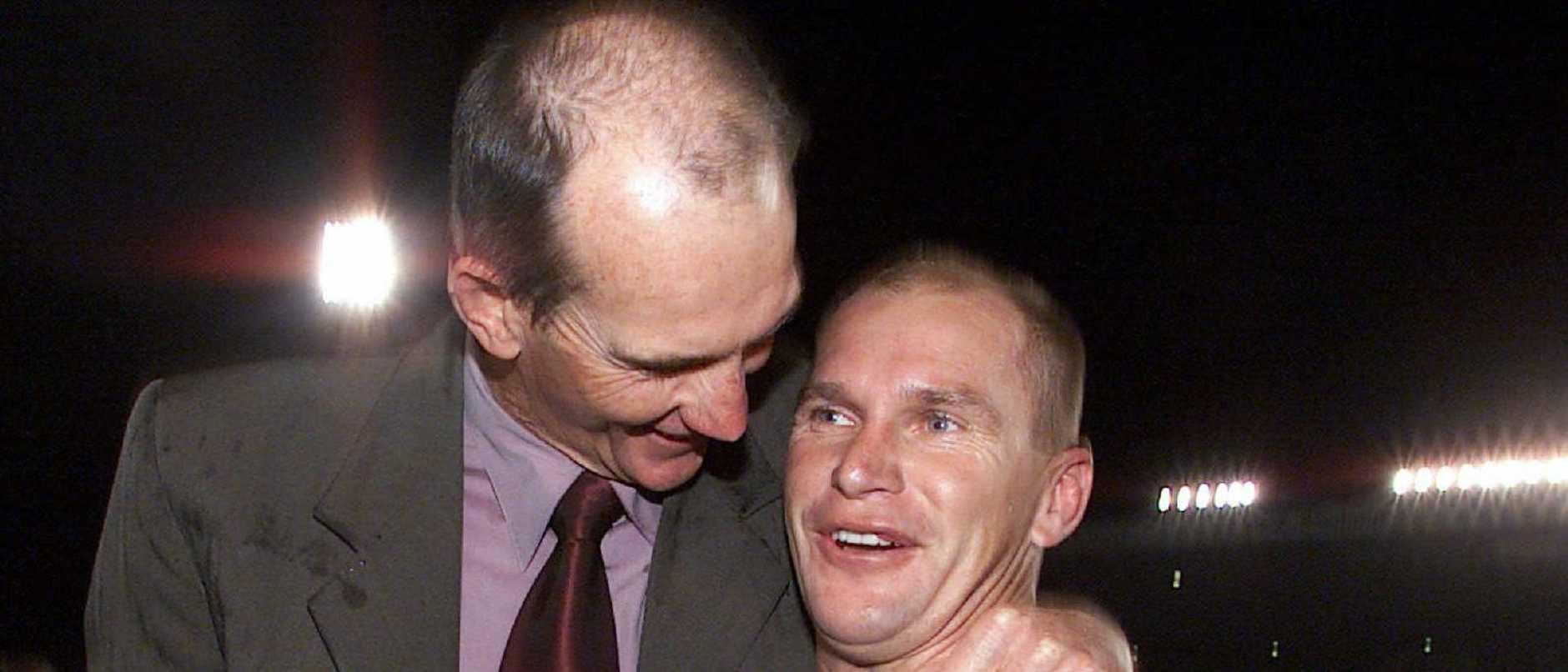 01/07/2001. A smiling Maroons coach Wayne Bennett embraces Alf Langer. Queensland v NSW State of Origin at ANZ Stadium.