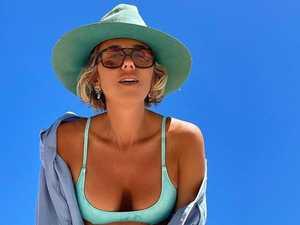 Clarke's girlfriend flashes abs in bikini