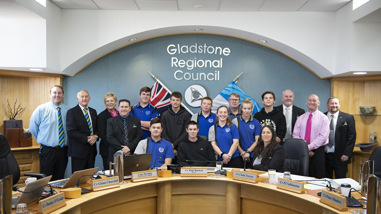 Miriam Vale State School students (L to R rear) Jamie Marriage, Matthew Smith, Robbie Farrell, Russell Jansson (teacher), Sam Munro and (L to R front) Jack Green, Kane Otto, Grace Dingle and Casey Robertson with Gladstone region councillors Kahn Goodluck, Glenn Churchill, Desley O'Grady, mayor Matt Burnett, Natalia Muszkat, Rick Hansen, Chris Trevor and Peter Masters at Gladstone Regional Council